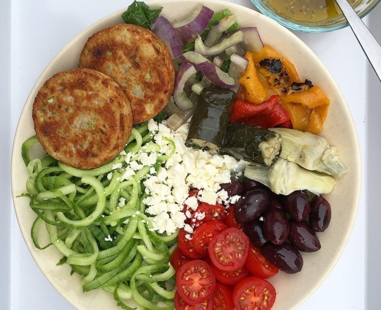 greek salad nourish bowl with broccoli cakes from Dr. Praeger's
