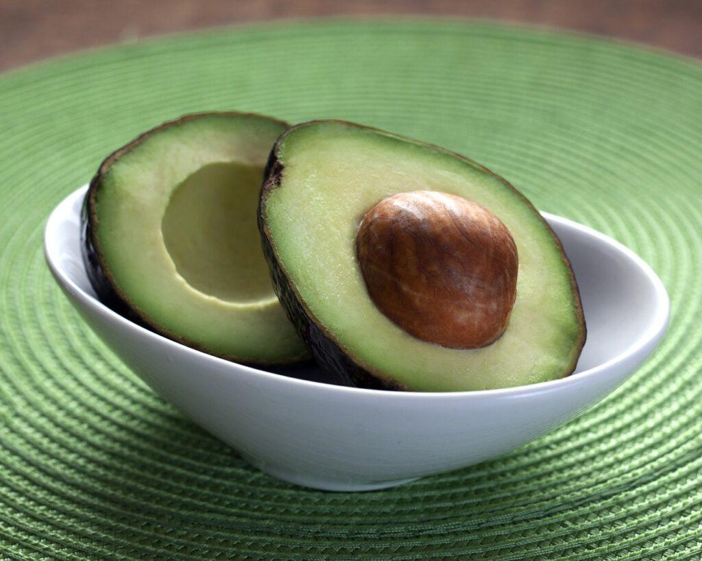 avocado halves sitting in bowl